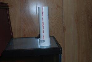 pvc pipe feeding tube setting on top of Polycarbonate lid.jpg